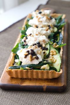 zucchini + spinach tart with whipped ricotta and rum-soaked currants.