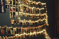 cute idea! hang photos onto white christmas lights using alligator style clothes pins. AWESOME!