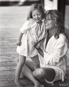 Patti Hansen in a Greg Lauren shirt and True Religion cutoff jeans, with Ida, in a Pink Chicken Womens tunic.