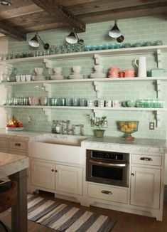 Green glass subway tile and shelving. Yes please!