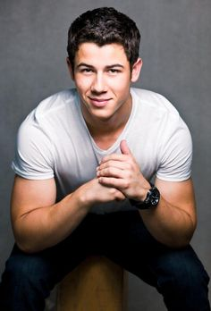 Nick Jonas  http://manhuntdaily.com/2013/10/the-jonas-brothers-have-split-up-none-of-em-came-out-yet/