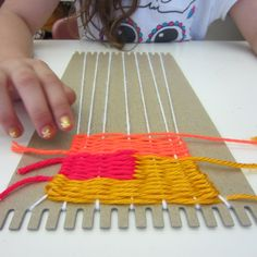 Weaving on a cardboard loom....I wonder if we could do a field trip to someplace that creates yarn and/or does great weaving and then do a loom like this?
