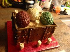 Game Of Thrones Dragon Egg Cake. Eggs are chocolate covered rice crispy treats. Fit for a Khaleesi!
