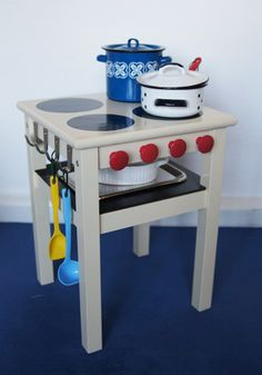 DIY Children Stove with Oven – Ikea Hack.  Link is in a foreign language, but the picture shows it well.  Cheap end table turned into toy stove.  I would have loved this as a kid!