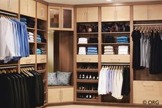 A tasteful two-tone closet for two appeals to his and her tastes. The corner nook provides a perfect seat to slip on shoes.    #closet #men #style #MensStyle #home #decorating #StayOrganized #SpringCleaning #spring #april #parents #mom #life #cleaning #SpringOrganizing
