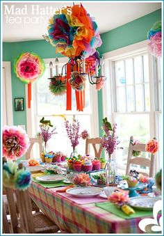 I love tissue paper flower like decorations, gorgeous colors for a colorful birthday table!