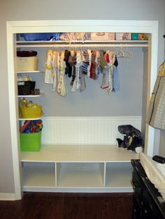great shelf at the bottom of closet for toy baskets