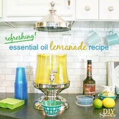 Drink recipe: refreshing lemonade using Young Living lemon essential oil at diyshowoff.com