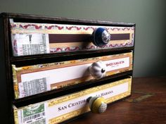 You can do sooo much with cigar boxes. They're cheap and make for good storage.