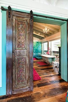 carved wood sliding barn doors and turquoise!!