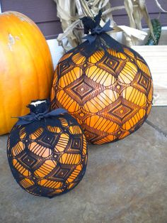 Black Tights stretched around a pumpkin. Clever use for those stockings with holes in the toes!