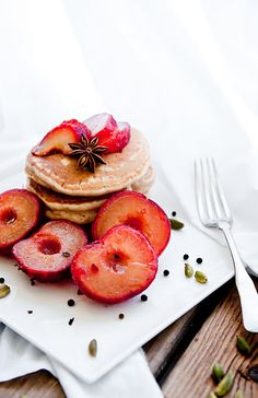 Chai pancakes with black tea poached plums