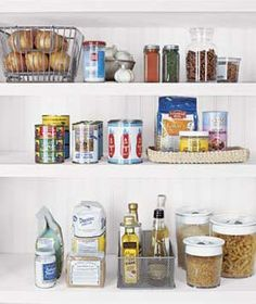 Organize your pantry shelves as you would a library, with food items grouped by category.