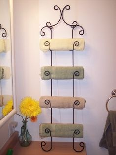 plate rack turned towel rack - also has an idea to use a plate rack as an outfit organizer for kids - one hook for each item of clothes so that they can see how an outfit looks and make sure that they don't miss anything.