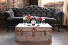 Trunk Table and grey couch