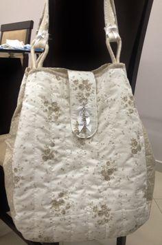 Bolsa de tecido de algodão.