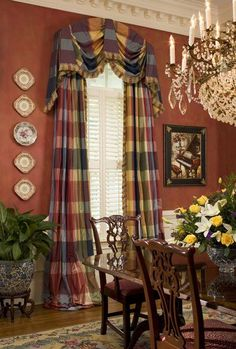 The arched valance & side panels complement this formal dining room well. I like the plaid fabric too.