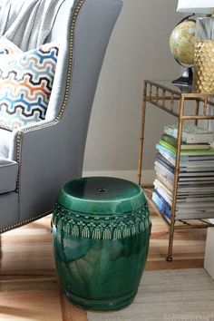 Transform a thrift store garden stool into a stylish piece for your living room!