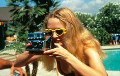 {Heather holding a Polaroid} via Boogie Nights; + heart sunglasses!