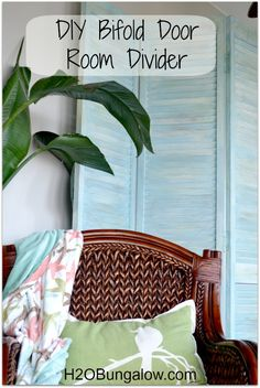 Repurpose a bifold door as a room divider ... and paint it a beautiful beachy color.