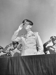 General Jonathan Wainwright Saluting During a Ceremony While Standing on a Raised Platform.After the fall of  Corregidor and MacArthur's leave for Australia Lt Gen .J. Wainwright was the commander of the Philippines.They held out until May 6th,and surrendered..then came the Bataan Death March.