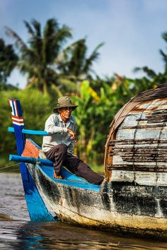 Tonle Sap Boatman by Christopher Waddell on 500px