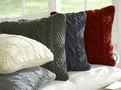 Find out how this Hometalk blogger repurposed old sweaters into cozy, cable-knit cushion covers.