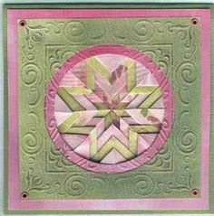 folded star quilt in green and pink...