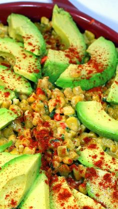 Esquites - Fried Mexican Corn with Creamy Avocado  Elote (the Corn on the Cob version of this recipe) and Esquites (this) are Mexican street food staples. Fried corn with a mixture of toppings is sold everywhere.  This recipe has some of the best options mixed with Fried Corn. Spicy Peppers, Creamy Cheese, Drizzles of Lime and Herbal Freshness! And with the addition of creamy sweet Avocados... TEX-MEX HEAVEN!