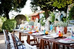 Countryside Tuscan Wedding colorful reception place settings