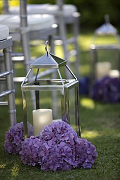 Silver lanterns with purple hydrangea. Ceremony aisle. Finishing Touch.