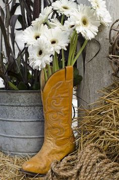 Western party decorations with a cowboy boot and flowers