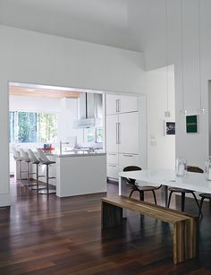 Bates Masi designed the two-inch-thick Carrara marble countertops and white fiberboard cabinetry in the kitchen of this Hamptons vacation home.