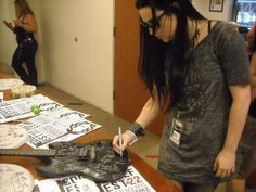 Amy Lee, signing a guitar at Edgefest!
