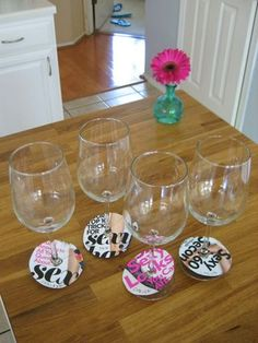 DIY: Upcycle old magazine covers  into wine glass markers.  Tutorial shows them using scissors but and Exacto knife might make it easier to cut.