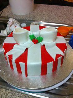 Christmas Cake, White chocolate mud cake, filled with white chocolate ganache, decorated with fondant.