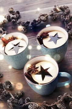 Apple stars in cider. Cut stars out of slices of apple and garnish with star anise.