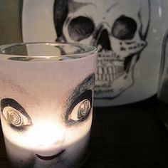 How to make creepy candles and other glassware using waterslide decals.