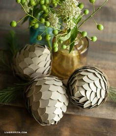 Great DIY Paper Pinecone tutorial. Love them in metallic or make them from old Christmas Cards!