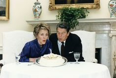 Ronald and Nancy Reagan celebrate their 33 wedding anniversary in the Oval Office.  3/4/85.