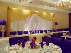 This #wedding using #bright #yellow and #purple as its #theme #colour. #Bright #yellow used on #backdrop, #head #table, and #purple on #chair #cover and #large #flower #ball on top of #pillars which makes the whole wedding looks #classic and #elegant.