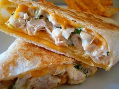 Cheesey grilled chicken wraps. We like a version of this with sweet & sour sauce and spinach with the chicken & cheese (and we grill them in our George Foreman grill)