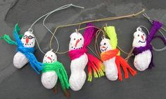 Peanut Snowmen Peanuts in the shells White spray paint or a bottle of white enamel craft paint Small inexpensive paint brush 7/16 size screw eyes Craft glue or E-6000 glue Puff paints in, black, orange and your choice of other colors (I chose colors to match the snowmen's scarves). Tiny colored pom pom balls. Chrysalis Neon Yarn from Yarn Bee- I got mine at Hobby Lobby Metallic thread or cord for hanging.