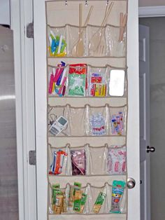 Shoe Organizer for Utensils  Free some space from countertops or cabinets with this sleek idea: Take an over-the-door shoe organizer from any home goods store and hang it on the pantry door or any other door in the kitchen. (The versions with clear plastic pockets are best, so contents are easily visible.) Then slip wooden spoons, spatulas, small appliances or snacks into the slots. bottl, small home organization ideas, organizing kitchen utensils, pantri door, clever ideas for home, door pocket organizer, uses for shoe organizers, organize pantry door, countertop