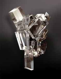 """William Haines designed the original """"Ice Crystals"""" Sconces for the May house in 1953, using faceted pieces of acrylic material.   This limited edition is offered as an exact opposing pair. Reflecting the sparkling glamour of Hollywood , the sconces are a brilliant accessory to traditional or contemporary interiors"""