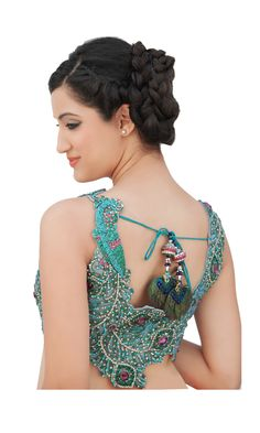 A V - neck blouse with net fabric care.Adorned with dancing peacocks, embellished with Swarovski crystals and stones.