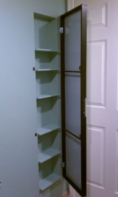 Cabinet built into bathroom wall. 5in deep shelves. Behind door. We really need to do this when we redo our bathroom.