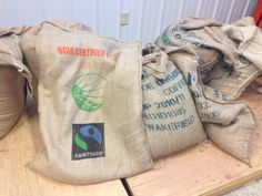 The lovely jute sacks hold the green coffee. Some are very pretty with the fair trade symbol and such. Then others are plain like the one with the green writing. It traveled all the way from Ethiopia. I love to get new coffees and look at the new bags. Coffee has traveled in these bags for hundreds of years.