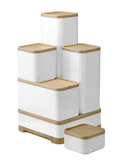 These modern, white plastic storage boxes come in multiple sizes and can be stacked to save space.