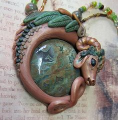 Fairy Luck dragon in polymer clay with rainforest jasper.  Green and brown magick fantasy